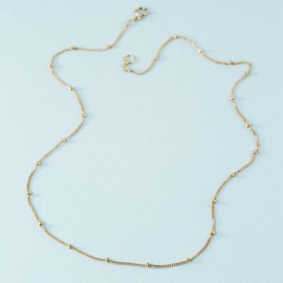 Simple 14k yellow gold necklace with nuggets