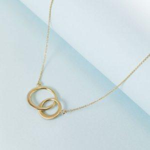 c92cb044b83b0e Model wearing double circle 14k golden necklace Gold double circle 14k